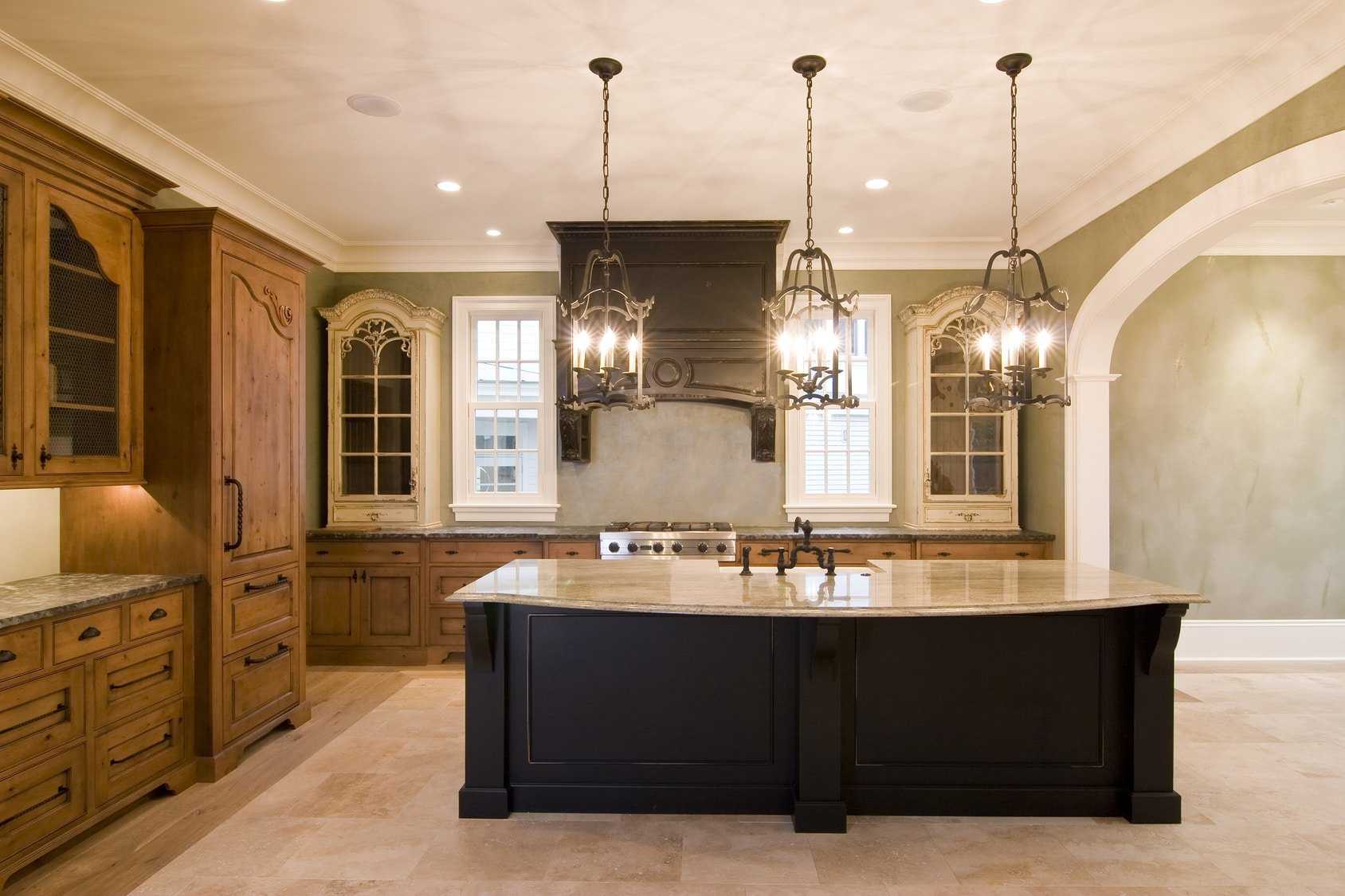 Opulent Kitchen In Complementary Colors With Granite Island